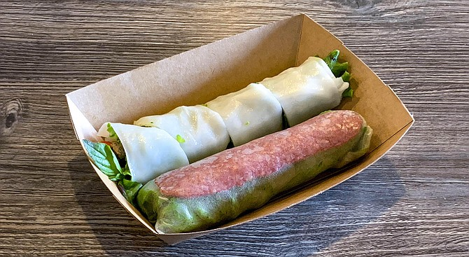 A grilled beef pho roll and Vietnamese sausage spring roll