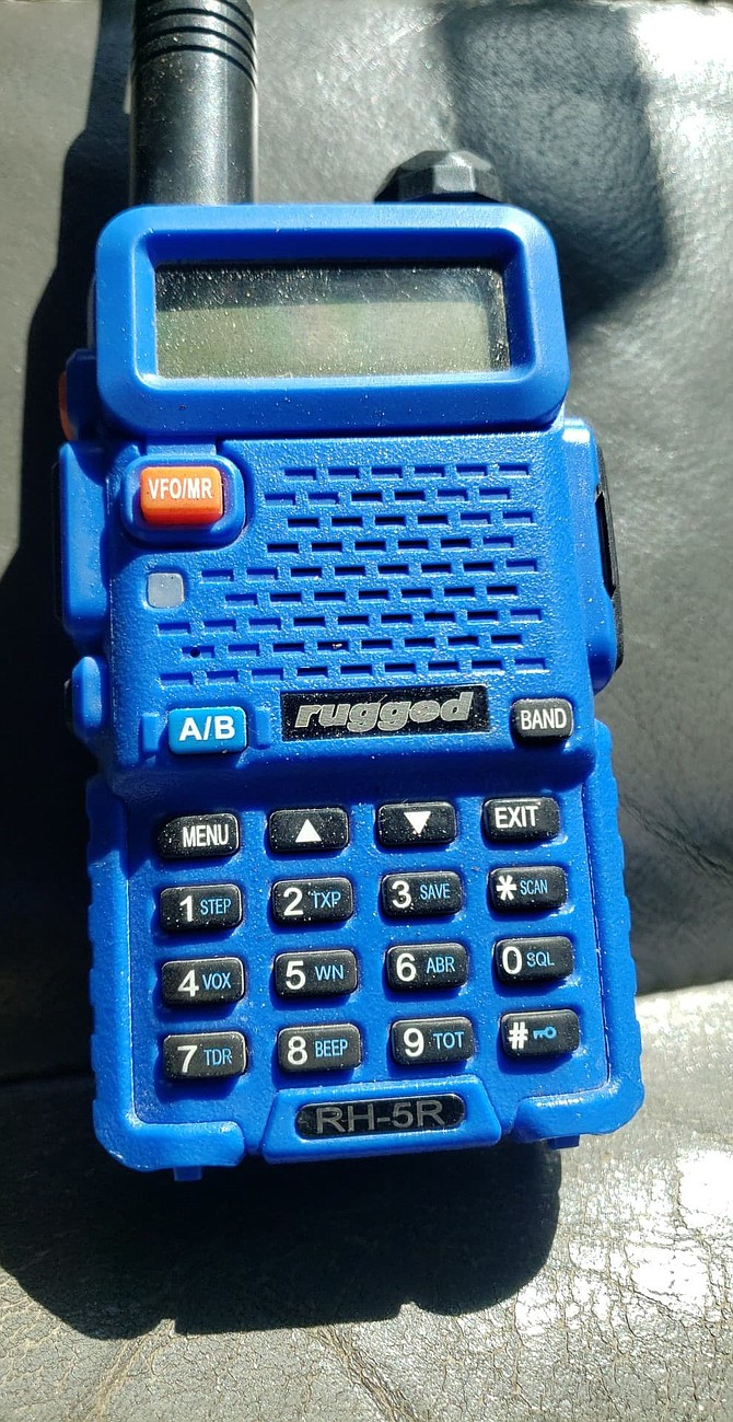 Race teams communicate with their support crews and with race officials via handheld radios such as this. Cell phones are worthless over much of the course.