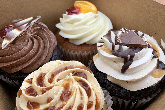 A box of cupcakes: (clockswise from left) chocolate raspberry, bloody orange, peanut butter, and vegan salted caramel