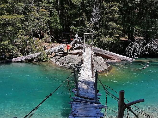 Crossing a sketchy-looking bridge on the Rio Azul.