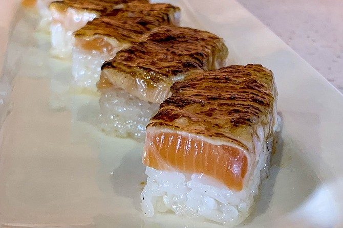 Salmon oshi aburi sushi: pressed into box-shapes and charred with a blowtorch