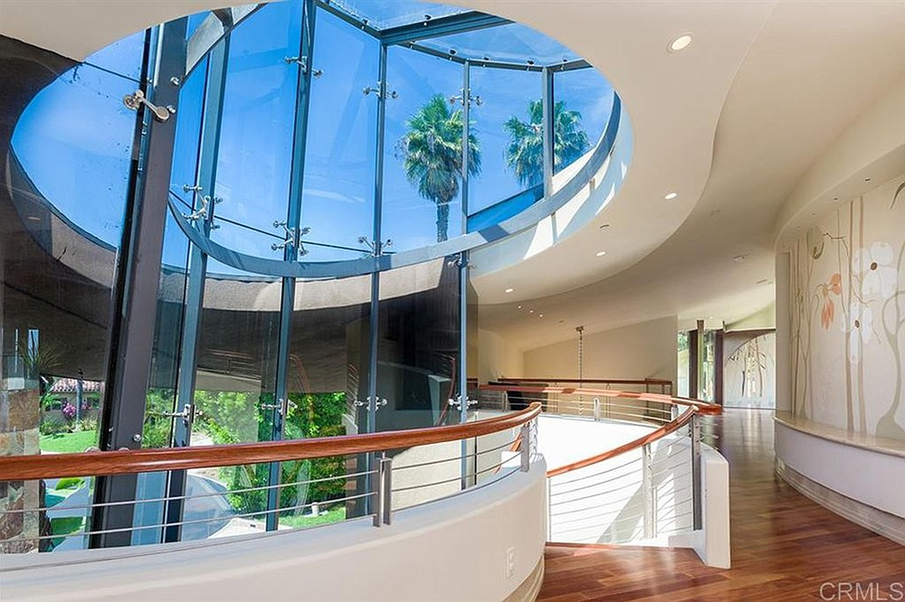 The second-level hall is accessible by spiral staircase, but there's also an elevator.