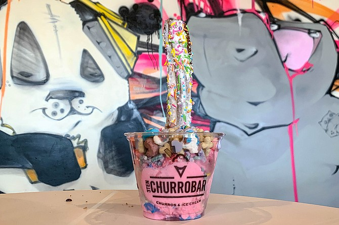 """Called """"Unicorn Oops,"""" this ice cream treat makes churros more colorful than the Spanish intended."""