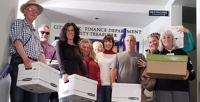 80 locals volunteered to get over 12,500 signatures.