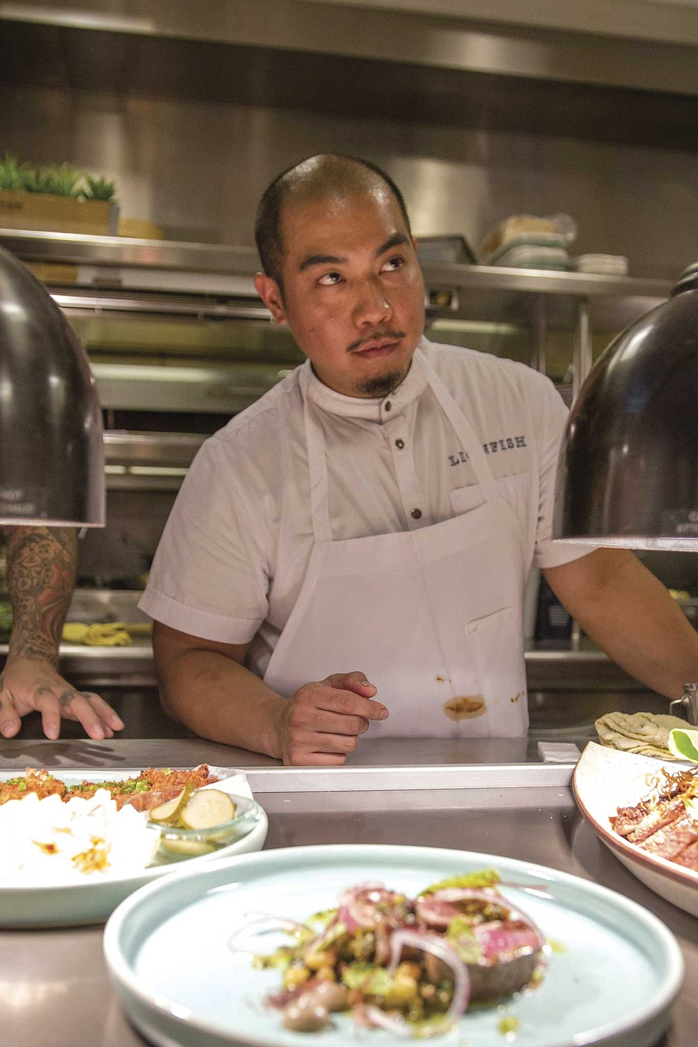 Ruiz and his chef de cuisine, Aaron Panganiban (pictured), have been going over recipes with their team, stepping from one station to the next, cooking and plating a single dish at a time.