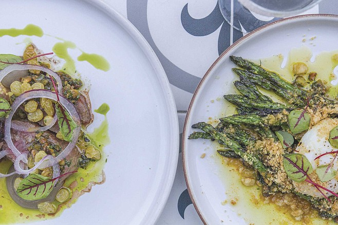 Pan roasted lamb striploin and grilled asparagus, both featuring pistachio aillade, at Lionfish.