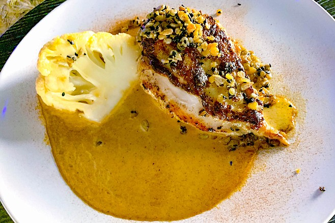 The meat entree — chicken breast — at Dinner With a View
