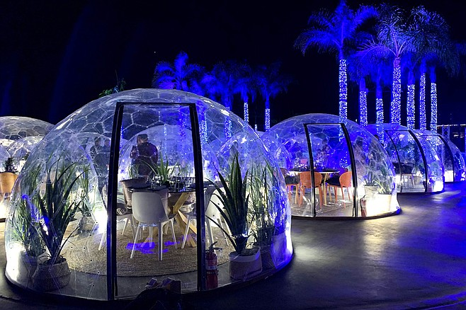 Geodesic domes and palm trees provide the view.