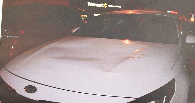 """Evidence photo of KIA damaged hood. """"This isn't Miss Goodbrand's first rodeo."""""""