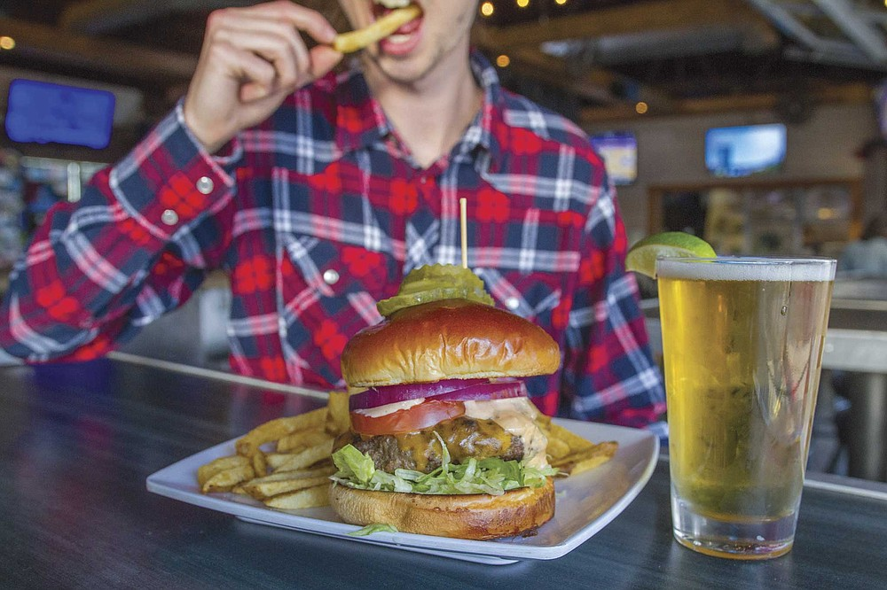 710 Beach Club's Monday night special: a satisfying pilsner and a respectable patty on a toasted bun.