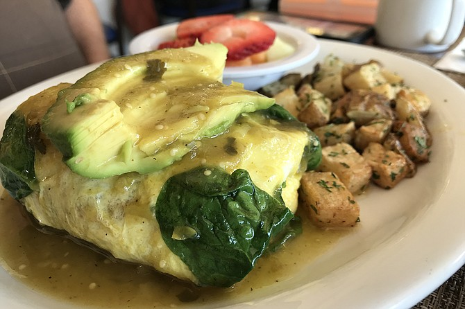 Rolly-polly and stuffed with spinach, the Verde Omelet.