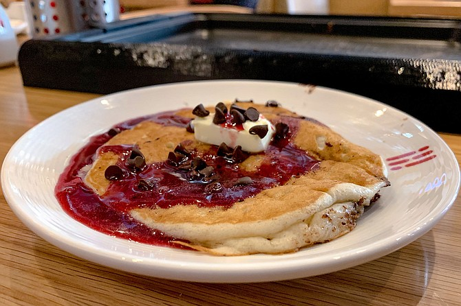 Banana bread pancake with chocolate chips and blueberry syrup
