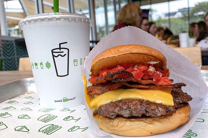 A burger and shake at Shake Shack Little Italy
