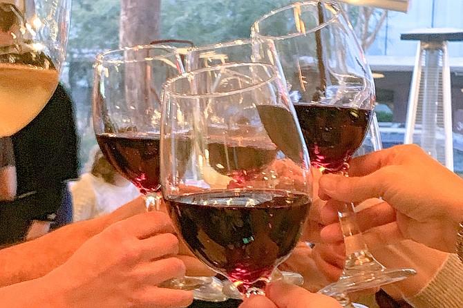 Clinking wine glasses is the new handshake.