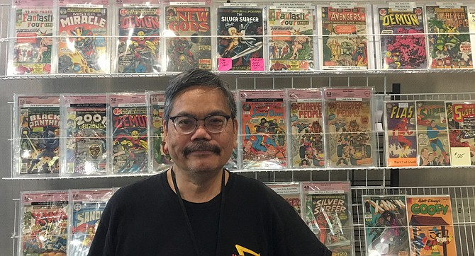 Stan Agbulos and a sample of his Kirby collection.