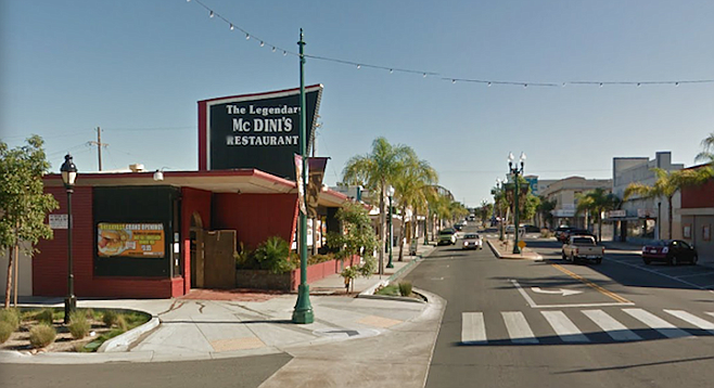 McDini's, a grandfathered bar, lost its alcohol permit.