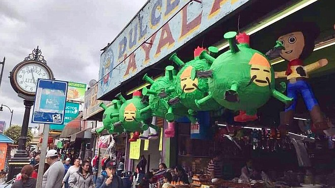 Candy shops created COVID-19 piñatas with a crude drawing of the face of a Chinese man pasted on a virus-shaped piñata.