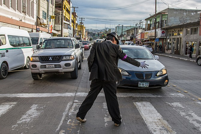 """El Michael Jackson"" dances for tips at busy intersections around Tijuana."