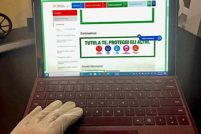 In Italy now, even laptops get the gloved-hand approach