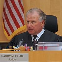 Hon. Elias presides.