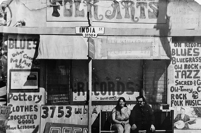 Lou and Virginia Curtiss in front of their old India Street location in Five Points.