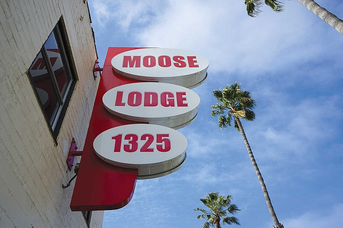 """""""A group of us was standing outside at 2 in the morning, looking at that giant Moose Lodge sign, all lit up, and we said, 'We have to do something about this place.'"""""""