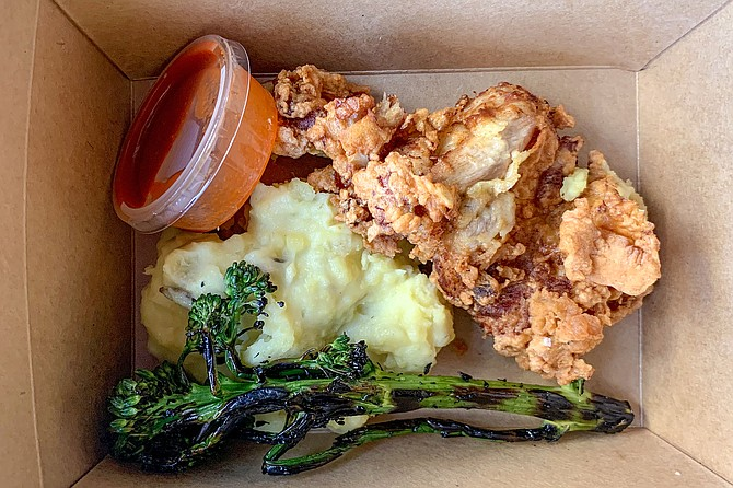 Fried chicken, mashed potatoes, and broccolini, made by Mission Avenue Bar & Grill for folks in need - Image by William Eik