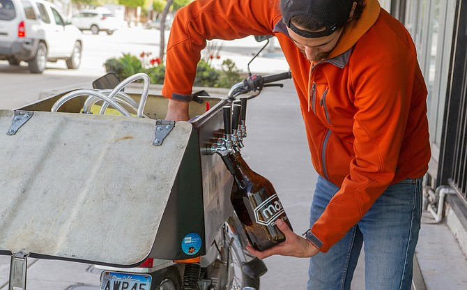 Luis Reyes.The motorbike carries a jockey box filled with three small kegs of five liters each.
