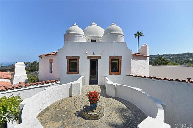 """Enjoy """"unique Indian vernacular architecture with Spanish Eclectic influences"""" in this La Jolla landmark residence."""