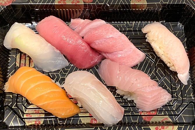Chef's selection nigiri from Azuki Sushi, including chutoro fatty tuna, otoro fatty tuns, yellowtail belly, sea bream, king salmon, and halibut.