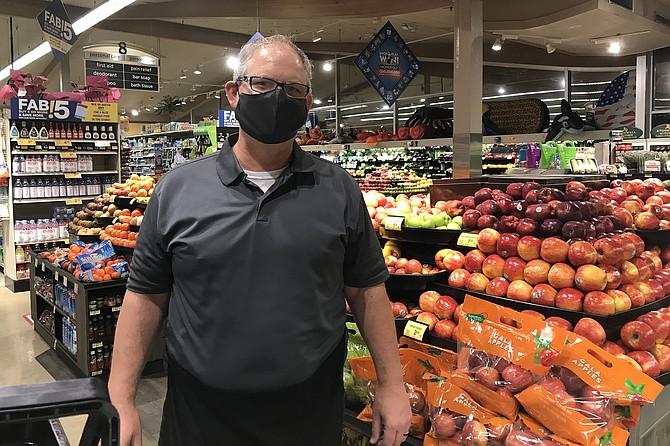 Supermarket's Philip Burow teacher, P-T bagger: calming influence among nervy customers