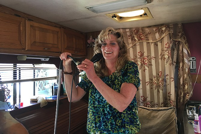 "Lois Hofmann in her RV, singing Loretta Lynn's ""You Ain't Woman Enough to Take My Man."""