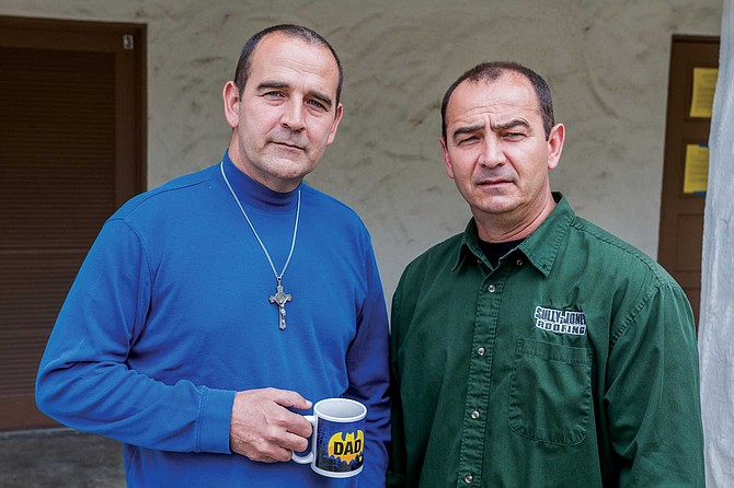 """Chris Sawaya (right) believes the coronavirus may have already """"blown through"""" his office. He and his brother Steve (left) are ready for life to go on."""