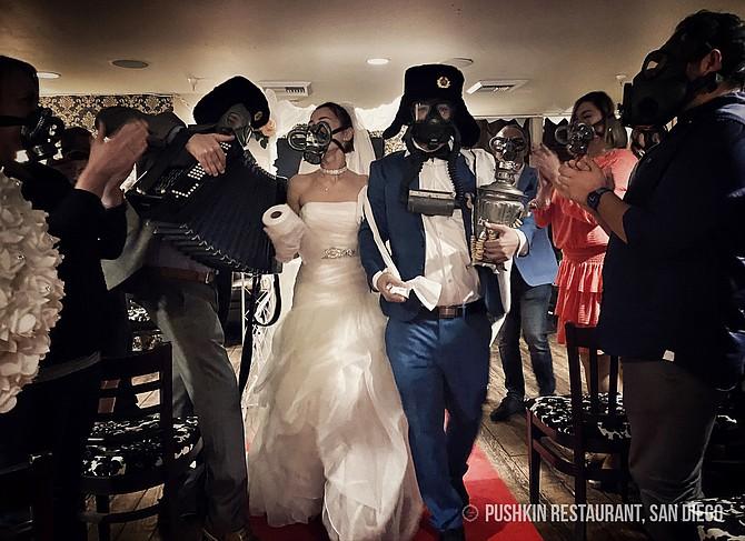Ike and Yulia Gazaryan's March 13 wedding renewal, held in vintage gasmasks at Pushkin Restaurant. - Image by Photo courtesy of Ike Gazaryan