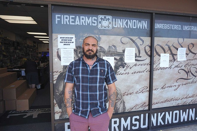 """Demetrius Karras is the media manager at Firearms Unknown in Oceanside. Most people who enter the store according to Karras are """"looking for something for the immediate situation and are not stockpiling weapons."""""""
