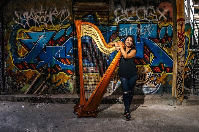 """The harp is six feet tall and weighs about 95 pounds."""