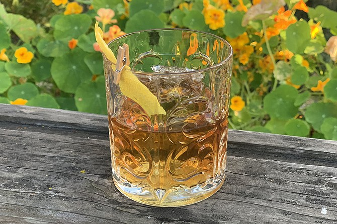 A poured at-home old fashioned from Madison on Park, with clip-on lemon rind
