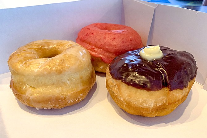 A trio of Solomon's donuts, including Bavarian cream and cherry glazed