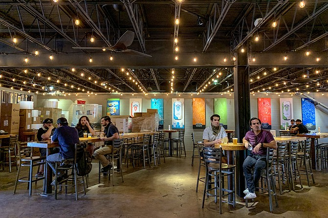 Shortly after noon on May 21, socially distanced patrons returned to the Mike Hess brewery in North Park for the first time since the statewide shutdown went into effect on March 17.