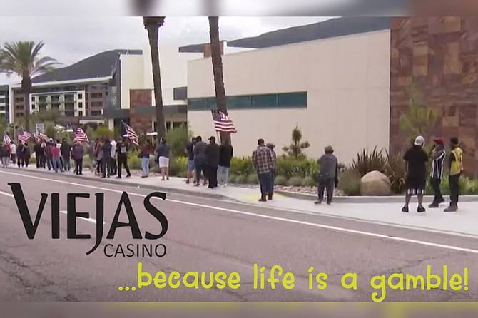 "Ad depicting line of eager patrons outside of Viejas on re-opening day. ""Life is like a casino,"" observes Viejas spokesman Ron Ponyup. ""Most people are suckers, happy to be governed by chance. A few pay enough attention to learn how things work, and they may do all right for a while. But eventually, the house wins — always. Everyone dies. May as well have some fun trying to beat the odds before the inevitable!"""