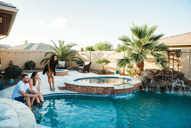 """Shannon Carlson, right, is a licensed real estate agent living in Phoenix's West Valley. """"They call it the California Wave 2.0,"""" she said. """"That's the jargon in Phoenix regarding the many transplants from California."""""""
