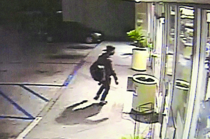Surveillance photo from the AM/PM on Tamarack in Carlsbad shows a man with a backpack.