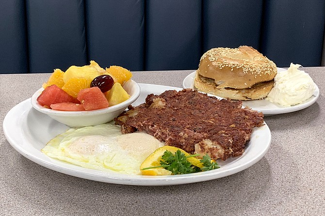 Corned beef hash and eggs, with fruit and a sesame bagel