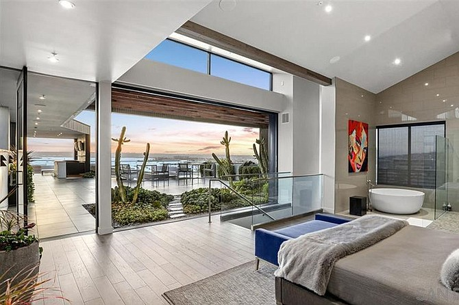 """The colossal patio provides """"a sensation of bringing the ocean and bay into the home."""""""