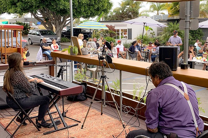 Local musicians perform for diners outside Homestead, in Solana Beach