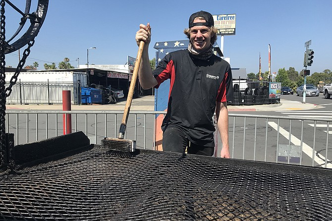 Manager Nick cleaning up after a morning's grilling.