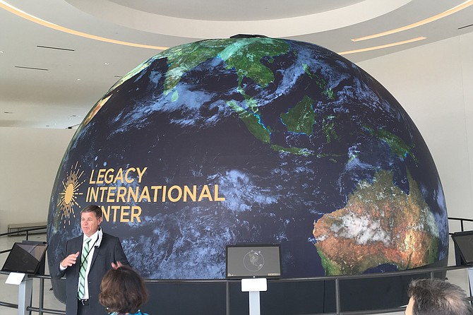 Executive Director Jim Penner introduces the interactive globe.