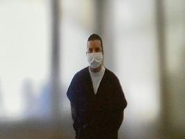 Jay Terry wearing his COVID mask, in custody.  Photo by Eva Knott.