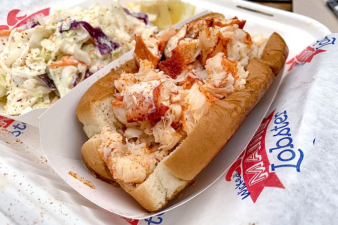 A Wicked Maine Lobster roll, served Connecticut style (warm, with butter)