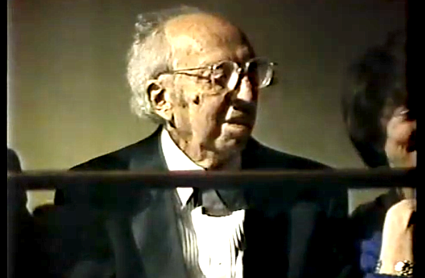 Aaron Copland listens to Leonard Bernstein conduct his music.